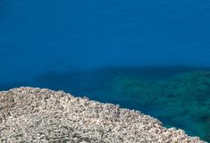 White rocks and blue sea, minimalistic sea background and textur Royalty Free Stock Photo