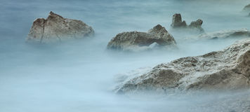White rocks in misty sea Royalty Free Stock Photo
