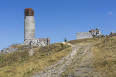 White rocks and ruined medieval castle in Olsztyn, Poland Royalty Free Stock Photos