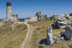 White rocks and ruined medieval castle in Olsztyn, Poland Stock Images