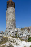 White rocks and ruined medieval castle in Olsztyn, Poland Royalty Free Stock Photography
