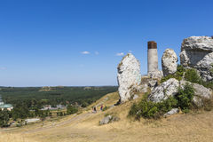 White rocks and ruined medieval castle in Olsztyn, Poland Stock Image