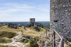 White rocks and ruined medieval castle in Olsztyn, Poland Stock Photos
