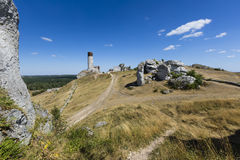 White rocks and ruined medieval castle in Olsztyn, Poland Royalty Free Stock Image