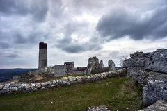 White rocks and ruined medieval castle Stock Images