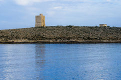 White Rocks Tower at dusk. The white rocks tower at dusk with its reflection in blue mediterranean Sea on the island of Malta Stock Images