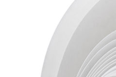 White roll of paper. Roll of a white paper background in the angle of a page Stock Images