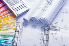 White rolled blueprints calculator and color Stock Photos