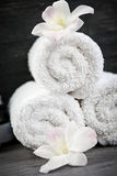 White rolled up spa towels Stock Photos