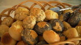 White rolls with poppy seeds lying in the basket stock video footage