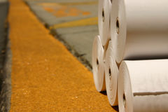 White rolls of printing paper on a loading dock. Ready for delivery Stock Images