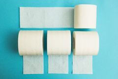 White rolls of toilet paper on a blue background stock photos