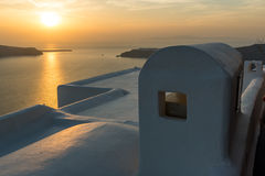 White roof and Amazing sunset in town of Imerovigli, Santorini island, Thira, Greece Royalty Free Stock Photo