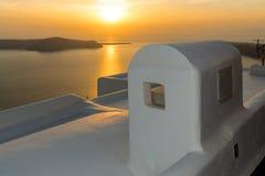White roof and Amazing sunset in town of Imerovigli, Santorini island, Thira, Greece Stock Photo
