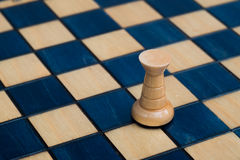 White rook on wooden chessboard Stock Photo
