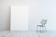 White room with blank picture and chair Royalty Free Stock Images