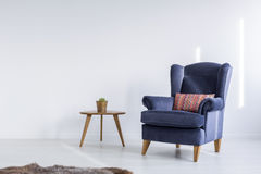 White room with blue armchair Stock Photos