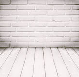 White room, brick wall and wood floor for background Royalty Free Stock Photo