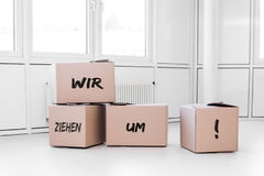White room with cartons Stock Images