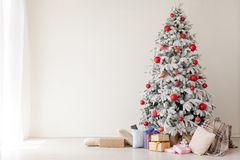 White room Christmas tree with red toys new year winter gifts decor royalty free stock photo