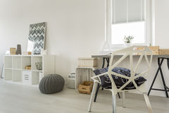 White room with crystal chair. White modern room with window, desk, crystal chair and cabinet Stock Photos