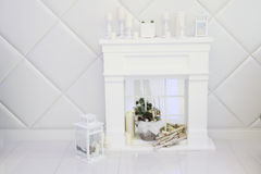 White room with decorative fireplace Stock Photo