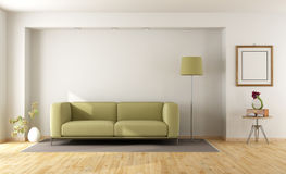 White room with green sofa Royalty Free Stock Images