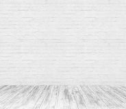White room interior with brick wall and wood floor Royalty Free Stock Image