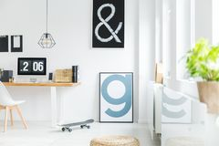 White room with letter posters. White minimalist room with letter posters and desk workspace Royalty Free Stock Photography