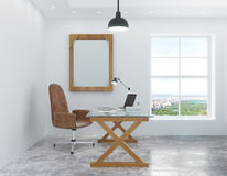 White room in the loft style with a desk and chair and a picture Stock Photography
