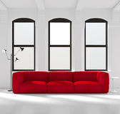 White room with a red sofa stock photos