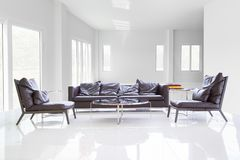 White room with table and sofa royalty free stock photos