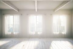 White room with three windows Stock Image