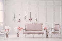 White room with vintage interior and spring flowers. White room with a vintage interior in the style of Provence and spring flowers stock image