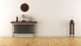 White room with vintage radiator. Empty room with vintage radiator and ethnic decor objects - 3D Rendering Stock Photography