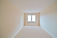 White room with window and radiator Royalty Free Stock Photography