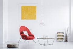 Two baskets in the corner. White room with yellow poster and two baskets in the corner Royalty Free Stock Photos
