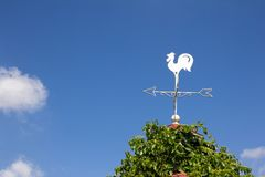 White rooster weather vane show the wind direction Royalty Free Stock Photography
