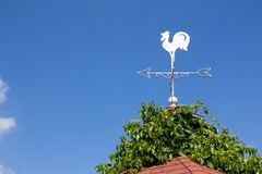 White rooster weather vane show the wind direction Stock Photography