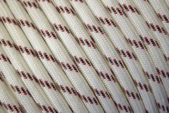 White rope. Detail shot of a coiled white rope Royalty Free Stock Photo