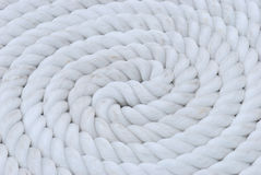 White Rope Coil. A coil of white mooring line rope for ship anchor Royalty Free Stock Photo