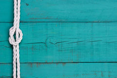 White rope with knot border on antique teal blue sign Royalty Free Stock Image