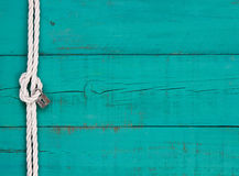 White Rope With Know And Silver Lock On Rustic Teal Blue Sign
