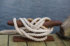 White Rope on Rusty Cleat Royalty Free Stock Image