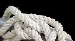 White rope tied to a pole. Stock Photo