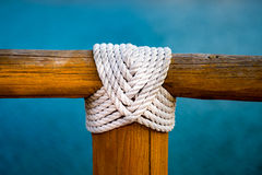 White rope wood cross on blue Stock Photography