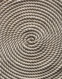 White rope on a wooden deck. Background for sea and ocean topic Royalty Free Stock Photography