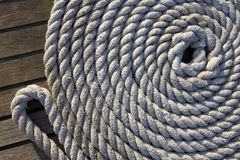 White rope on a wooden surface Stock Photos