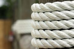 White rope wrapped around dock pier post Royalty Free Stock Photo
