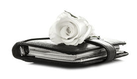 White Rose on black Filofax. White Rose and black Filofax on white background Stock Images